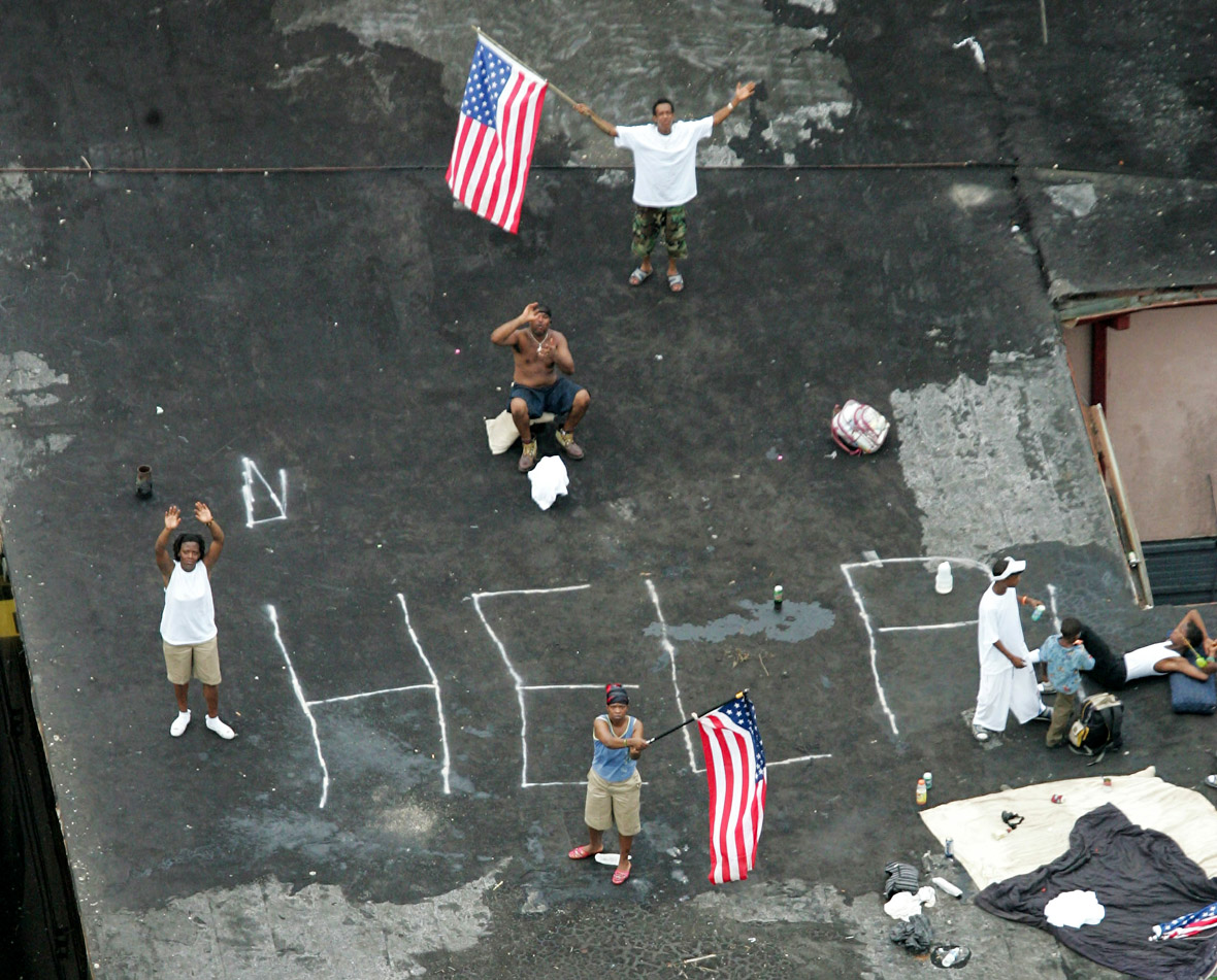 Residents wait on a roof top to be rescued from the floodwaters of Hurricane Katrina in New Orleans ..